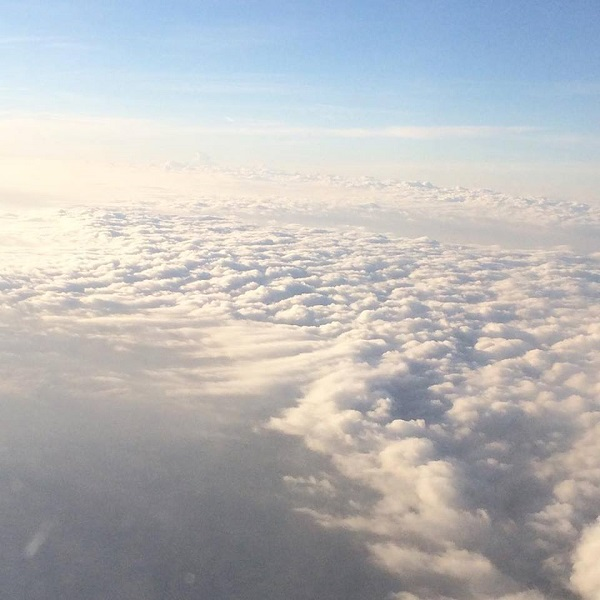 Head in the clouds.  (A shot from the plane on the descent into Green Bay. Home again!)